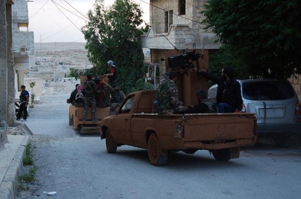 İşte Suriye'deki savaşın fotoğrafları - 27 Mayıs 2014 12