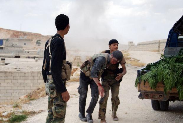 İşte Suriye'deki savaşın fotoğrafları - 27 Mayıs 2014 4