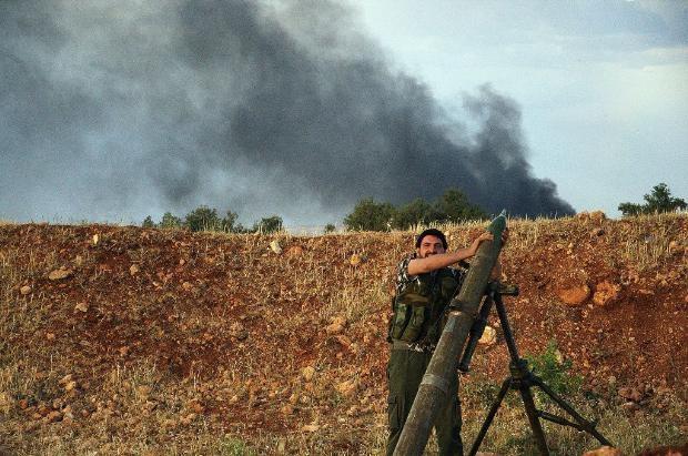 İşte Suriye'deki savaşın fotoğrafları - 27 Mayıs 2014 6