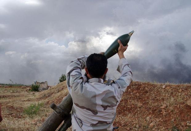 İşte Suriye'deki savaşın fotoğrafları - 27 Mayıs 2014 7