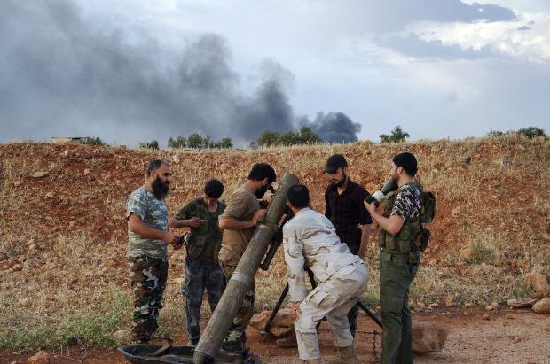 İşte Suriye'deki savaşın fotoğrafları - 27 Mayıs 2014 8