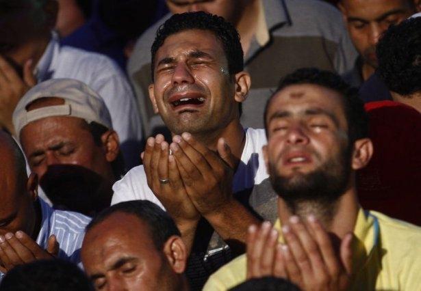 Rabia katliamının acı fotoğrafları 31