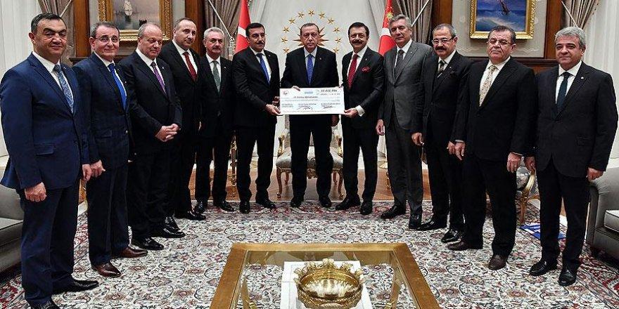 15 Temmuz şehitleri için toplanan yardım çeki Erdoğan'a takdim edildi
