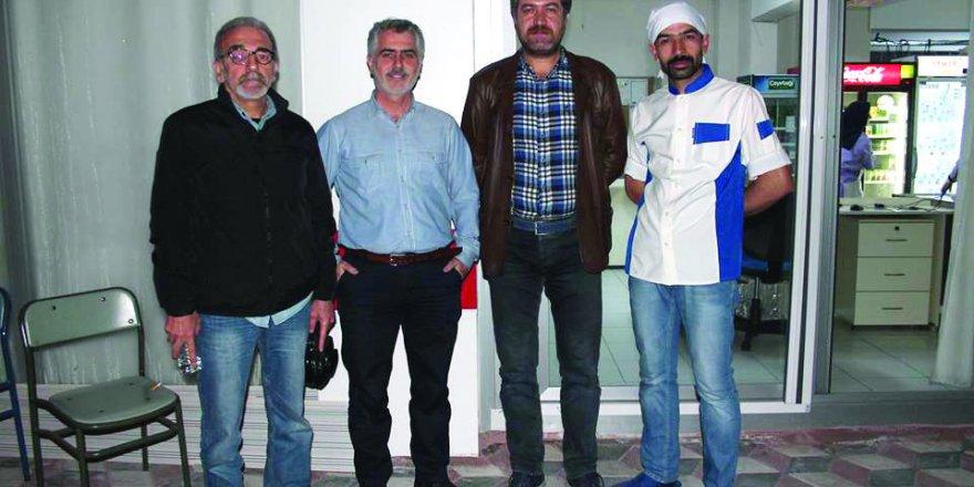 Ali Ulvi Kurucu KYK çalışanları omuz omuza