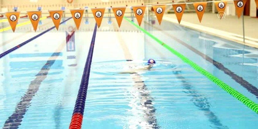 Engelleri yüzerek aştı